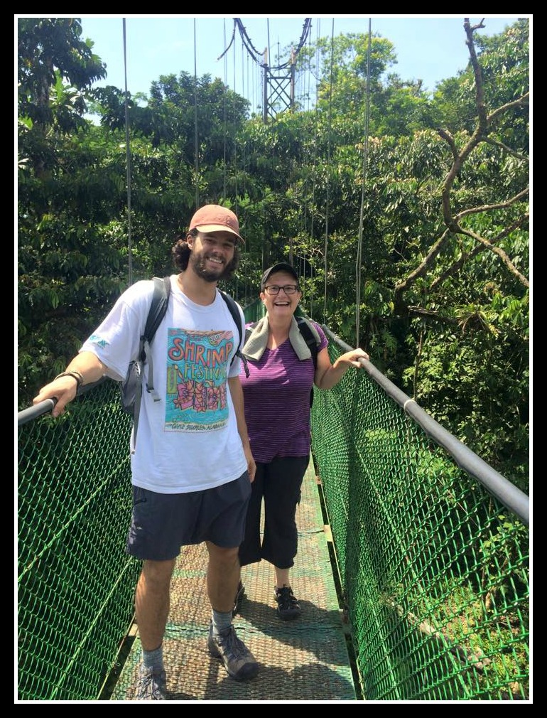 Karen and friend crossing a bridge in Costa Rica. mysideof50.com