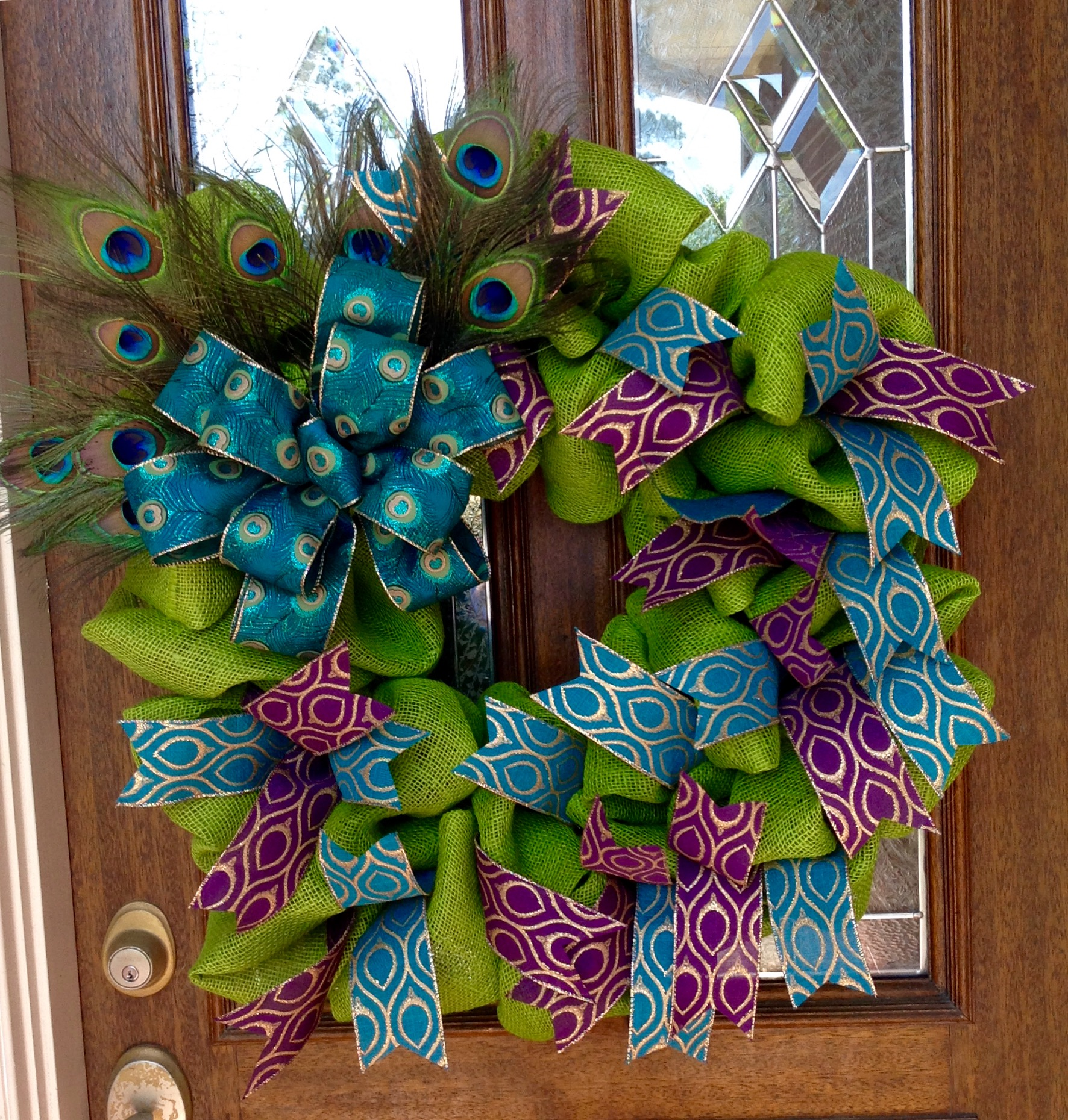 Green Burlap Wreath with Peacock Accents by Whimsical Wreaths by Amy