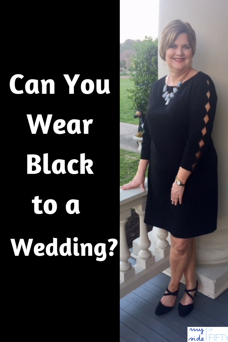 "Black text box with white text ""Can You Wear Black to a Wedding?"" Man wearing suit & tie. Woman wearing Talbots Refined Ponte Sheath in Black. 3/4 length scalloped sleeves. Kendra Scott Harlow Statement Necklace. Black Rosie Pumps from Walking Cradles 