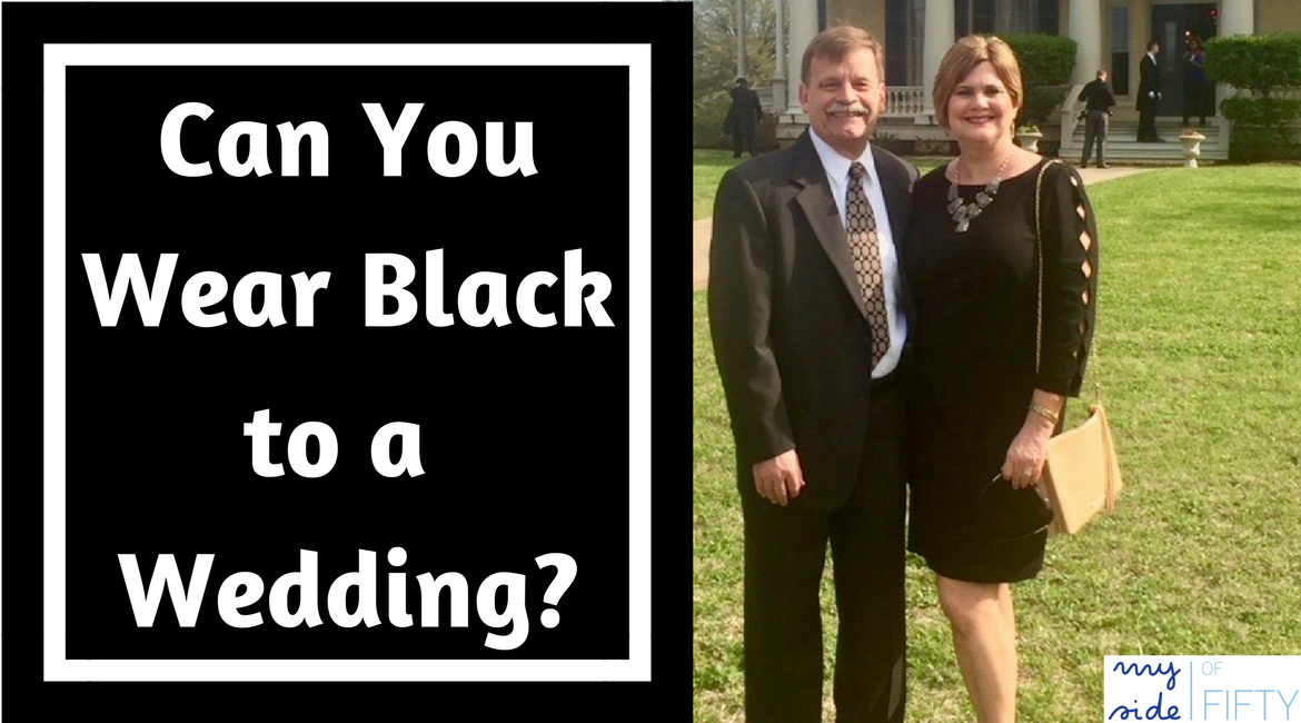 "Black text box with white text ""Can You Wear Black to a Wedding?"" Man wearing suit & tie. Woman wearing Talbots Refined Ponte Sheath in Black. 3/4 length scalloped sleeves. Tan Elaine Turner purse with fringe tassel. Black Rosie Pumps from Walking Cradles 