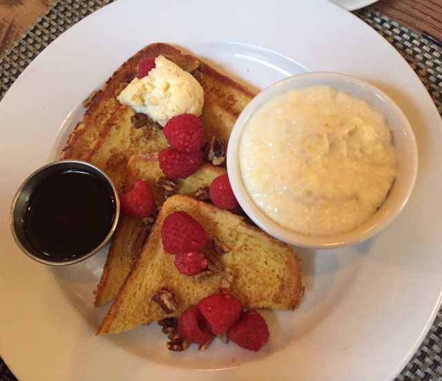 Plate of French Toast with Raspberries and Syrup