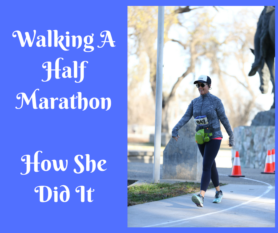 Fitness Over 50 | The Walking Half Marathon | Picture of woman in athletic wear walking in a walking half marathon | Text on Picture says Walking A Half Marathon | How She Did It
