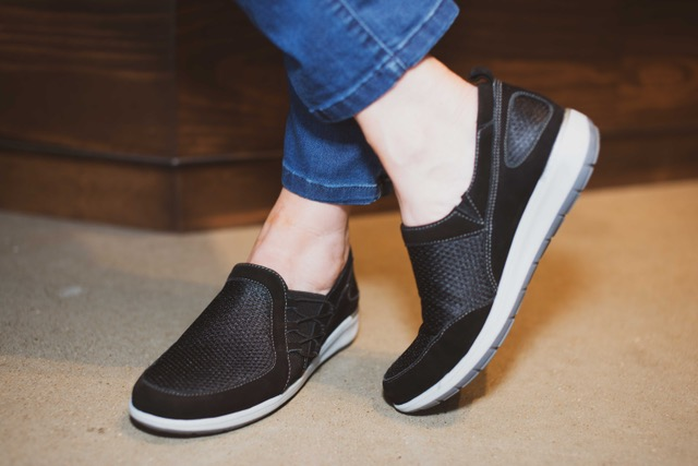 Women's Fashion Sneakers | The Walking Cradles Metro Collection | Picture of woman's feet wearing black Onyx slip-on sneakers from Walking Cradles Metro Collection