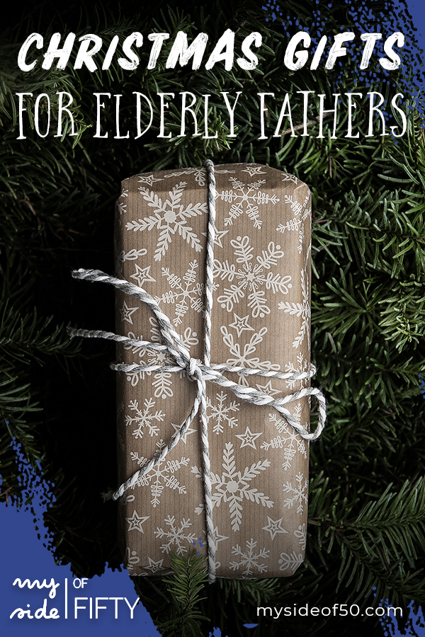 Gifts for Elderly Fathers | Christmas present wrapped in brown paper with snowflakes and string bow